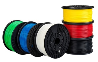 Reels of 3D printing filament in different colours